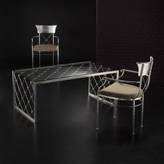 Wrought iron table with a contemporary cut crystal , made entirely by hand by Effe.Bi Artistic Wrought Iron . Florence , Italy.
