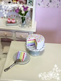 This listing is for a sweet pastel rainbow cake and a slice cut from it. It includes the doily, cake stand, plate and fork. Only the sliced cake is