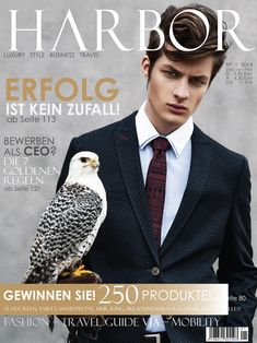 Dino Busch Poses with Owls for Harbor Magazine