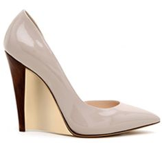 Casadei patent pointed-toe sculpted wedges $275,