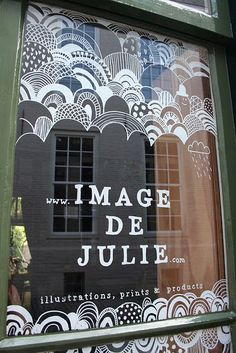 Beautiful window drawings! Something like this can be done with liquid chalk markers - it dries and won't smear until you wipe it with wet cloth.