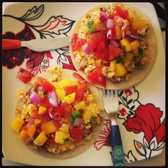Lime cilantro brown rice, sausage, eggs and cheese scrambled on top of corn tortillas topped with home made mango salsa!