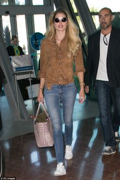 Keeping it casual: Doutzen Kroes looked fresh as she walked through Nice airport on Friday afternoon