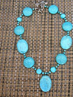 Beautiful Round and Oval Coin shaped Turquoise Necklace.  4 hrs left.  Get it while it's hot!  This piece is a mere $28.00!