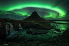 Aurora over Kirkjufell, Iceland - David Clapp. Some say the Aurora is the spirits of dead animals and men (in their true, animal form) as they spend their nights on dancing across the twilight sky. I may believe that it is caused by disturbances in the po Aurora Borealis, Wildlife Photography, Landscape Photography, Museum Photography, Scenic Photography, Night Photography, Landscape Photos, Amazing Photography, Mind Blowing Images