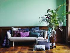 Bras sofa designed by Khodi Feiz for Artifort covered in POM Amsterdam pillows.