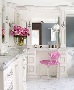 High end white marble and custom cabinetry vanity area of a bathroom.