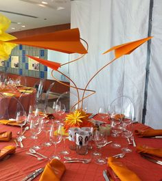 2012 Opening Gala, Ann & Robert H. Lurie Children's Hospital of Chicago. Table centerpiece of large scale paper airplanes and hand cut paper flowers designed by Jami Darwin