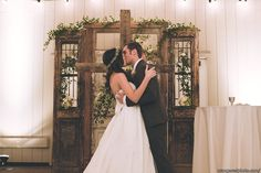 Rustic door and cross alter backdrop at Strawberry Farms Wedding