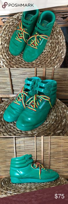 "Rasta reggae Reebok classic hi tops These shoes are awesome! Gently worn about two times by my daughter a few years ago. They are bright green with kind of gloss finish. Red yellow and green laces. Size 7. I always wanted Sue from "" The Middle"" to wear these! In excellent condition and super funky!  These might be Japan only version I'm not sure , but I bought in Japan. Reebok Shoes Sneakers"