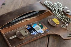 Leather Biker Wallet Leather iPhone 5 Wallet Case by JooJoobs. I like this, but with a few alterations Leather Tooling, Leather Men, Distressed Leather, Biker, Diy Wallet, Handmade Leather Wallet, Leather Pattern, Leather Projects, Wallet Chain