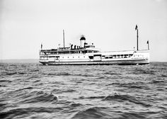"""A third boat, """"The Straits of Mackinac"""", joined the fleet in 1928 and provided service across the Straits until the opening of the Mackinac Bridge on November 1, 1957.  This boat was built for the Highway Department to carry approximately 35 vehicles.  Within two years, the ferry was modified with an upper level loading area which increased the capacity to 90 cars and up to 400 passengers.  For many years, """"The Straits of Mackinac"""" was considered the flagship of the Michigan State Ferry…"""