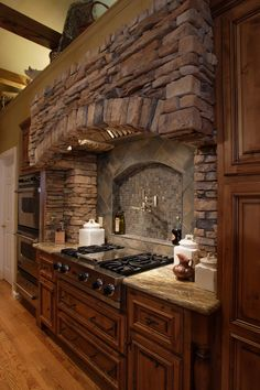 Kitchen Design Trends: Range Backsplashes - Callier and Thompson - Stone range backsplash! Kitchen Stove, New Kitchen Cabinets, Kitchen Backsplash, Backsplash Ideas, Stone Backsplash, Kitchen Hoods, Kitchen Fixtures, Kitchen Island, Rustic Kitchen Decor