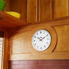 A built-in clock is functional and adds period flair to this kitchen