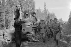 German tankers salute inspecting Finnish General Hjalmar Siilasvuo leading a Finnish officer delegation. July 1, 1941.