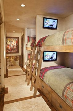 This luxe lake house has plenty of room for guests...& each one has his or her own TV! How cool is that?? V