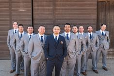 Groom & Groomsmen attire Navy blue suit with polka dot tie Grey suits with navy polka dot tie Photo by DC Photography Studios in Fresno,CA Venue - Panoche Creek River Ranch in Fresno, CA Coordination by The Social Spree in Fresno, CA