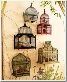 birdcages- fill with succulents, candles, copper animals for a porch wall?