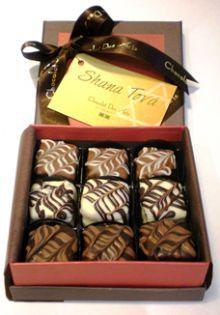 Pães de mel - Chocolate belga ao leite com doce de leite, chocolate branco com framboesa, chocolate 53% cacau com damascos.