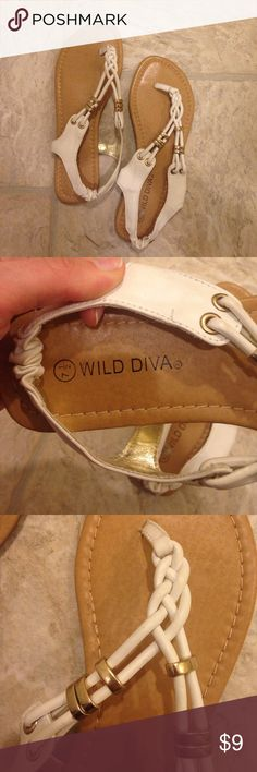 Wild Diva Sandals White and gold thong sandals! Got these in highschool and only wore them once or twice. Size 7 1/2 and practically new! The back strap is cinched and a little stretchy so they're easy to get on. Selling them bc they're just a little too fancy for my style. Let me know if you have any questions :)  Wild Diva Shoes Sandals