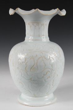 CHINESE POTTERY, Yinqing Vase with incised decoration, light glaze, foliated lip rim. Yuan Dynasty, in custom box.