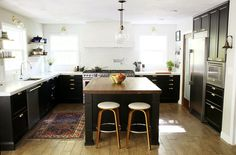 Even with black Ikea cabinetry in the Laxarby finish, Chris and Julia managed to make their renovated kitchen feel light and open, thanks to open shelving on one side. Aside from saving with Ikea cabinetry, this talented couple tackled their own concrete countertops. Check more details and pictures of their kitchen transformation! Ikea Kitchen Renovation Ideas | POPSUGAR Home