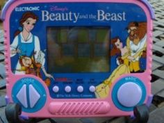OMG I COMPLETELY FORGOT I USED TO HAVE THIS!!  1990 Beauty & the Beast Toy hand held Tiger Electronics.  Good times.