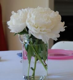 White peonies in a canning jar vase make an elegant and simple wedding table centerpiece. Peonies Centerpiece, Flower Centerpieces, Wedding Flower Decorations, Wedding Table Centerpieces, Wedding Ideas, Wedding Inspiration, Table Decorations, Tulip Wedding, Wedding Flowers