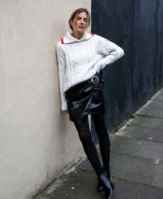 A cable-knit tucked into a miniskirt with tights and patent boots.