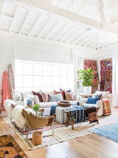 layered rug slipcovered furniture pillowsBefore + After: Shoppe (via Bloglovin.com )