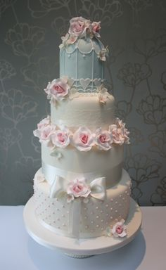 A Vintage birdcage wedding cake with romantic pink roses and hydrangeas. www.choosecake.co.uk
