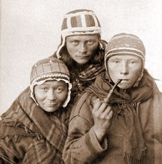Three Sámi women, one smoking a pipe, wearing their traditional caps. c.1890. [1296 × 1314]