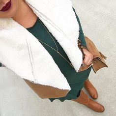 See this Instagram photo by @mixandmatchmel • hunter green swing dress fleece shearling vest dark lips gold tassel necklace riding boots saddle purse fall winter fashion