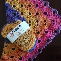 Not my work but illustrating the Caron Cake in Funfetti color in virus shawl pattern