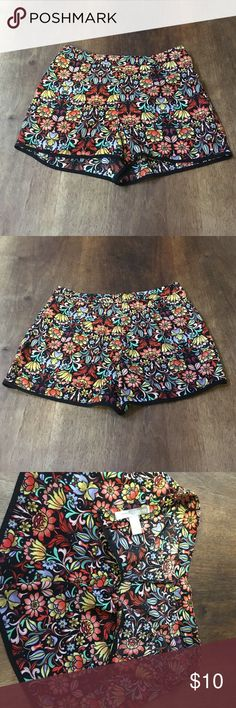Oh, So Springy Floral Shorts These oh so springy shorts are very short and very cute. They measure 12 inches in length and the waist measures 25 inches. They are made of 100% poly. No snags, no tears, no rips, no stains, and no fading. For more vintage collectibles check us out at www.GardienDeMiel.com Forever 21 Shorts