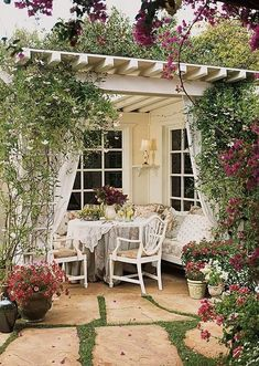 Lots of photos of gorgeous pergolas with tips on how to create the perfect setting.  Also links to where to buy nice patio string lights Creative Juices Decor: Need More Living Space? Add a PERGOLA - Top Tips Gallery and Ideas (shabby chic with flagstone pavers off white)
