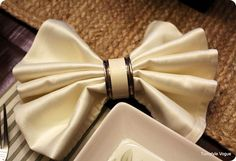 Simple accordion fold to create Easter Bow with linen napkins.