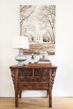 Your antique carved chest could sit where the larger chest is now, in the middle of the living and dining room wall. not much needed here, a large print or modern art piece, a lamp and whatever else you would like. Books even!