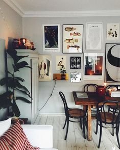 small home dining room with gallery wall and white wood plank floors Interior Exterior, Home Interior Design, Interior Designing, Room Inspiration, Interior Inspiration, Uo Home, Sweet Home, Decorating Your Home, Living Spaces