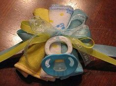 Tie burp cloths together for a baby shower corsage