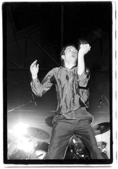 post-punker:  Ian Curtisfrom Joy Division,at Futurama, Queen's Hall, Leeds, September 8, 1979,by Kevin Cummins