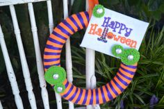 Orange and purple striped Halloween wreath by ShuhpuppyAndDeppy, $25.00