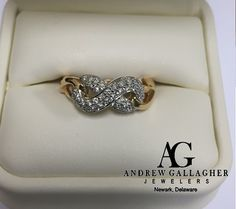 (11/18/15) 50% OFF! 14K Yellow Gold Diamond Infinity Ring. The diamonds are set in 14K white gold.  The total Diamond weight is 0.34 carats. Original Retail Price: $1450.00 SALE PRICE: $725.00. | Item#: D5066 | Call Andrew Gallagher Jewelers at 302-368-3380 for more information. We SHIP!! | #50OffJewelryCase