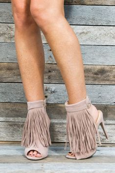 Stay classy in our boho stiletto sandal that commands the spotlight. These heels reveal a taupe faux suede, cascading fringe, and a sexy ankle cuff. The open toe and open back design are casual enough