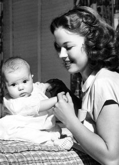 Shirley Temple and daughter Linda Susan, at home, 1948