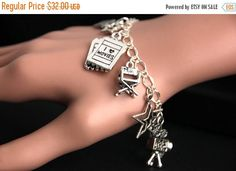 SUMMER SALE Movies Bracelet. Movie Lover Charm Bracelet. Hollywood Bracelet. Movie Star Bracelet. Silver Bracelet. Handmade Jewelry. by GatheringCharms from Gathering Charms by Gilliauna. Find it now at http://ift.tt/2tfXv31!