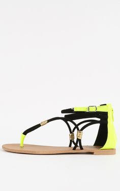 Funky and cool, neon strappy flat sandals. These would look so good with a summer outfit!  | MakeMeChic.com