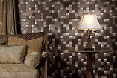 I can't believe these are sticker tiles!  They adhere to the wall effortlessly.  Truly DIY..  www.nappatile.com