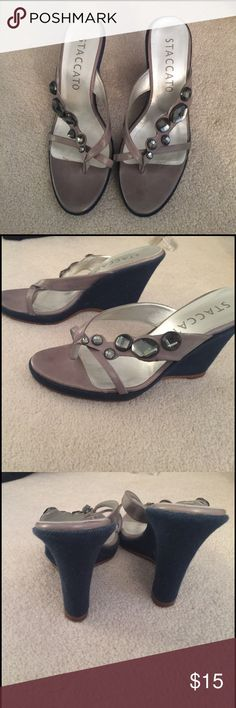 Staccato wedges comes with dust bag Lightly worn - shoe runs small more like a size 8 staccato Shoes Wedges