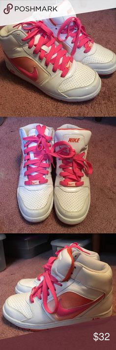 Pink and white Nike air high tops Pink and white Nike Air high tops. Pink laces. Size 7.5. Nike Shoes Sneakers